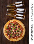 bottle beer and pizza on a... | Shutterstock . vector #1471383479