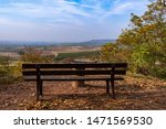Bench overlooking the landscape of Rhenish Hesse/ Germany in autumn