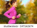 woman running in autumn fall... | Shutterstock . vector #147162674
