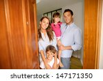 family standing on the entrance ... | Shutterstock . vector #147171350