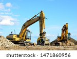 Two Yellow Excavators At A...
