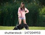 Stock photo girl and her faithful husky 147204953