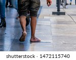 Bare Feet Of A Homeless...