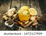 Small photo of Fall immune system booster - ginger and turmeric tea and ingredients, rustic wood background