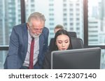 manager boss is helping and... | Shutterstock . vector #1472307140