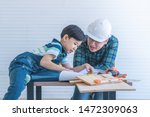 engineer father is teaching his ... | Shutterstock . vector #1472309063