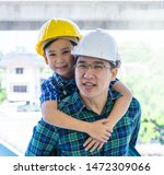 builder father is carrying his... | Shutterstock . vector #1472309066