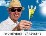 handsome happy man drinking... | Shutterstock . vector #147246548