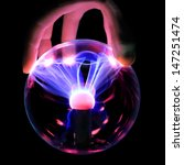 Hand Holds A Plasma Ball With...