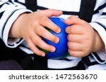 Ball Globe In Baby Hands. The...