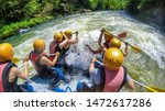 Adventure Team Doing Rafting On ...