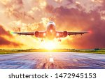 airplane lands on runway with... | Shutterstock . vector #1472945153