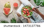 woman in jeans eating fresh... | Shutterstock . vector #1473137786