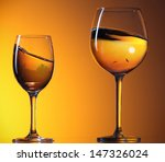Two Wine Glasses With...