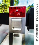 Small photo of Fire department emergency operation switch at the entry of a park. Red Fire Department normal operation and emergency operation switch.