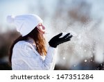 girl playing with snow in park | Shutterstock . vector #147351284