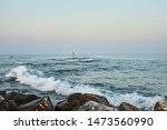 views from a breakwater on the... | Shutterstock . vector #1473560990