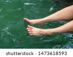 Female Tourist Relaxing Her Happy Legs in the Hotspring Water Pond.