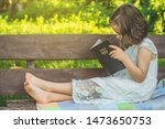reading the holy bible in... | Shutterstock . vector #1473650753