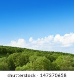 clouds in the sky above the forest - stock photo