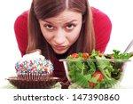 A Girl Deciding Between Cake O...