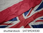 Stock photo waving colorful flag of great britain and national flag of poland macro 1473924530
