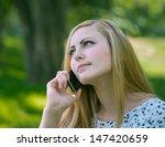 beautiful young woman talking... | Shutterstock . vector #147420659