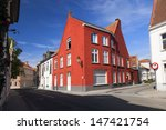 Red house and blue sky in Brugge, Belgium  - stock photo