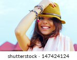 portrait of a young smiling... | Shutterstock . vector #147424124