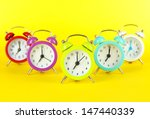 colorful alarm clock on yellow... | Shutterstock . vector #147440339