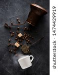Small photo of Coffee making background. Coffee pot, cup coffee with smoke, coffee beans, sugar and sugar tongs, top view, flat lay