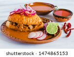 tortas ahogadas, traditional Mexican Food from Jalisco Guadalajara Mexico, spicy sandwich in a red sauce