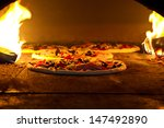 pizza cooking in a tradition... | Shutterstock . vector #147492890