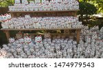 Stock photo an array of maneki neko or lucky cats or beckoning cats or fortune cats in the place of their 1474979543