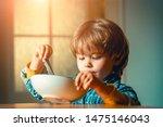 Kid Eating. Little Boy Having...