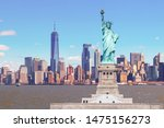 The Statue Of Liberty With The...