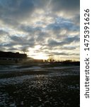 Small photo of winter cloudy sky sunset overtop field