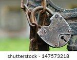 The Old Lock Through A Chain...