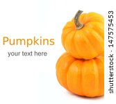 Two Stacked Mini Pumpkins Over...