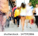 motion blurred shoppers. long... | Shutterstock . vector #147592886