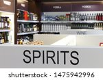 Showcase of alcoholic beverages in the duty-free shop Conceptual photo.