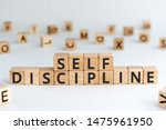 Small photo of Self discipline - words from wooden blocks with letters, self-discipline concept, random letters around, white background