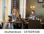 beautiful pregnant woman using... | Shutterstock . vector #147609338