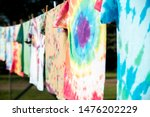 Stock photo a row of colorful tie dye t shirts hanging outside on a clothesline in the sun 1476202229