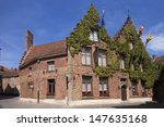 House with vines in Brugge, Belgium  - stock photo