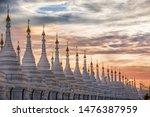 Pagoda series in line at sunset in the Mandalay region, Aungmyaythazan in Burma. Sanda Muni Pagoda, Place of religious Buddhist worship.