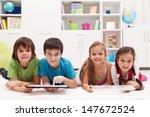 happy kids using tablet... | Shutterstock . vector #147672524