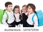 Back to school theme with group of children having backpacks - closeup - stock photo