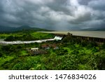 Small photo of Pune, India - August 11 2019: The Pawna dam during the monsoons near Pune India. Monsoon is the annual rainy season in India from June to September.