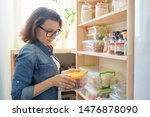 Woman At Home In Kitchen  Near...
